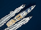 Bold yacht cruising with her tenders
