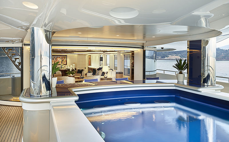 Excellence yacht main deck pool and saloon