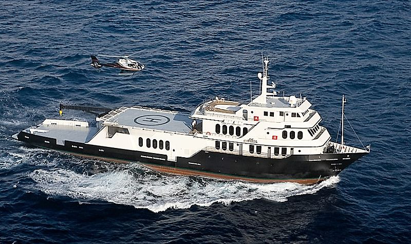 Global yacht cruising with helicopter
