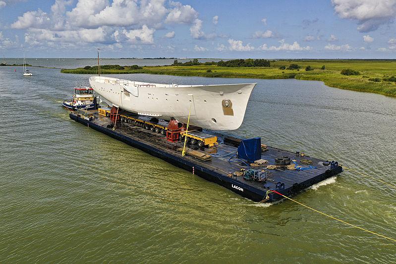 Hull of yacht Istros arriving in Makkum