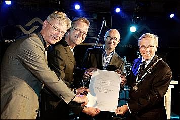 From left to right: Carel Meijers, Henk de Vries and Tom de Vries accept the official Royal designation from the Mayor of Aalsmeer.