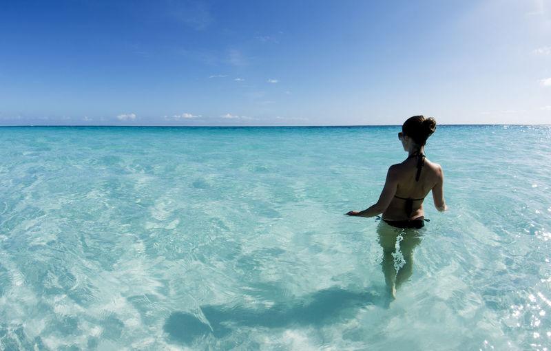 Woman in ocean for Bahamas DOTM article