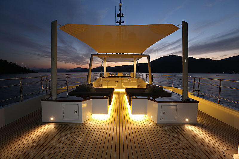 Only Now yacht sundeck at night