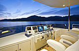 Only Now yacht flybridge at night