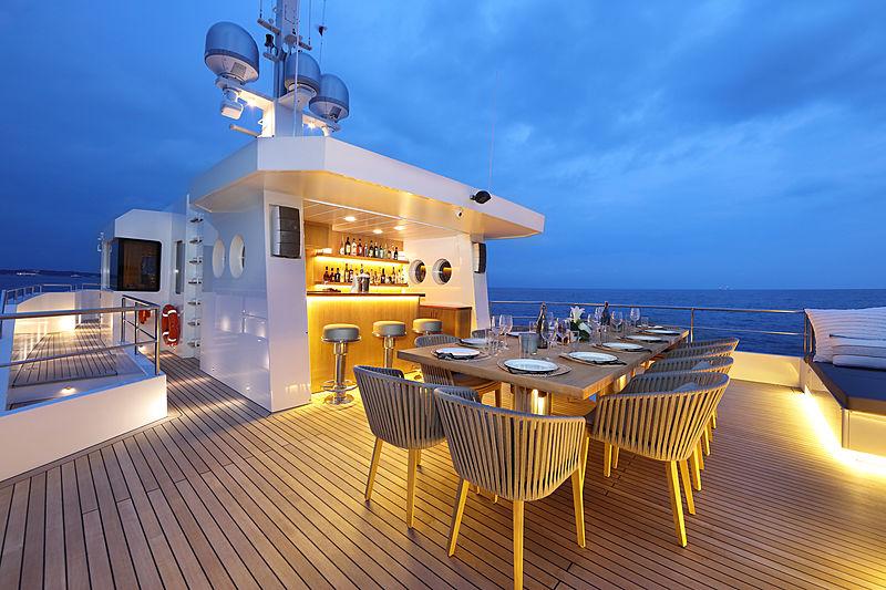 Siempre yacht aft deck at night