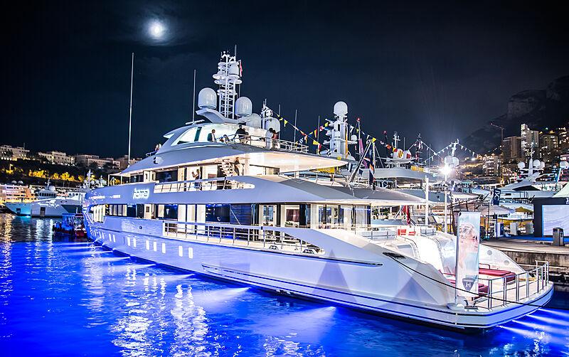 Heesen yacht Home in marina with underwater lights