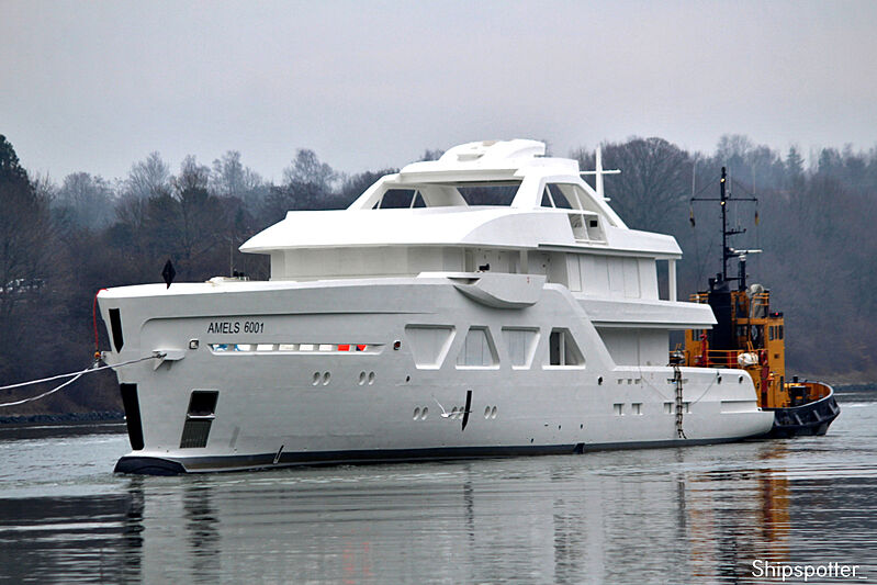 Amels 6001 yacht hull on transport at Kiel Canal