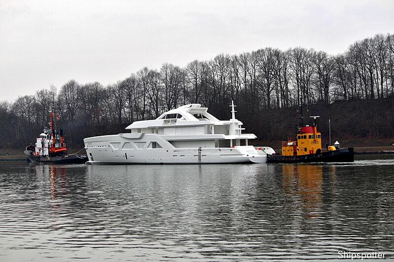 Amels 6001 yacht hull on transport at Kiel Canal