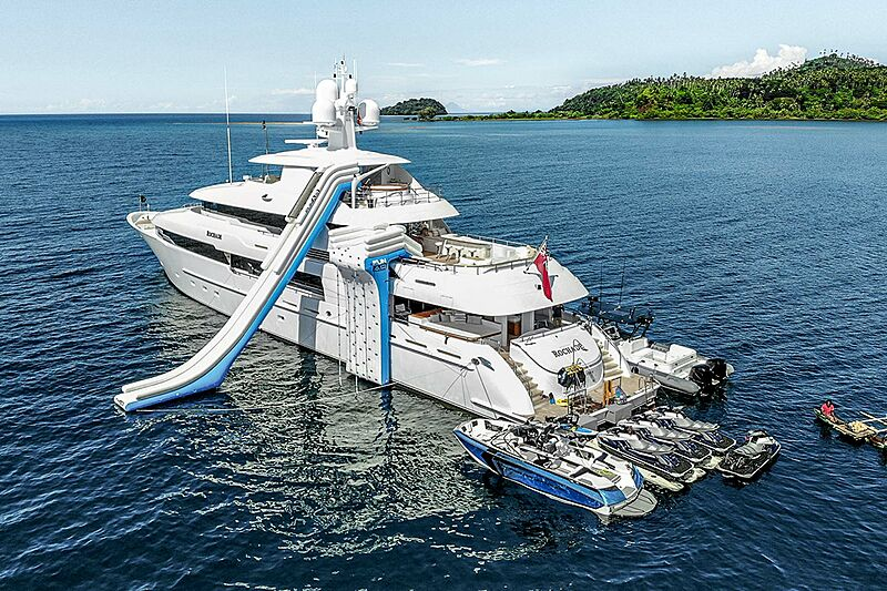 Rochade yacht anchored with tenders and toys