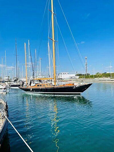 Telstar yacht off marina