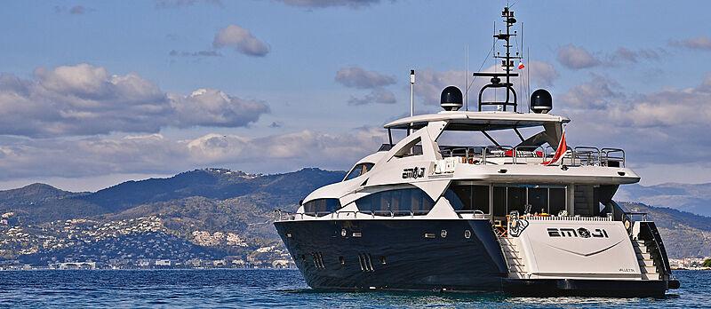 Emoji yacht anchored