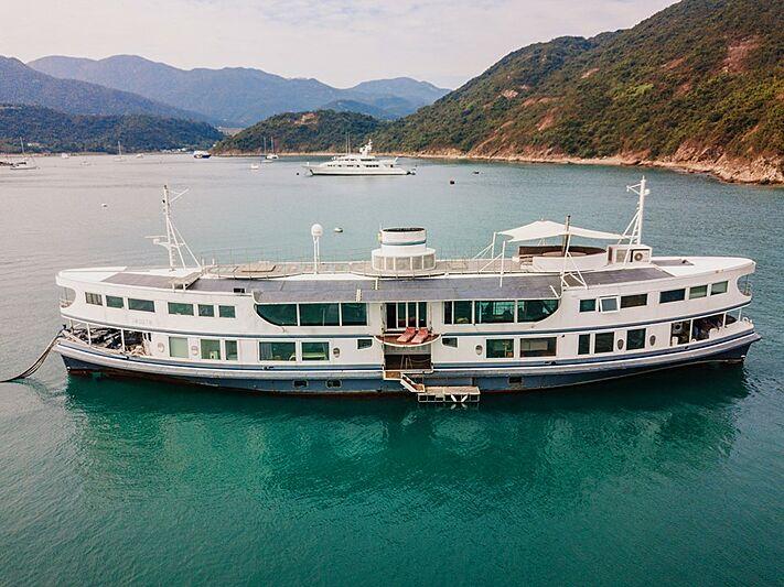 Dot yacht anchored
