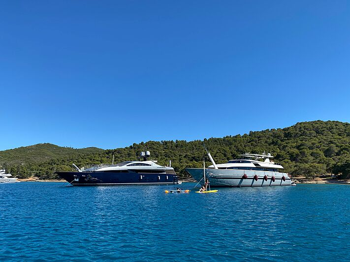 Lucky Me Yacht Academy and Illusion yachts anchored off Spetses