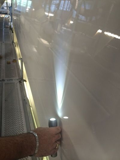 CCS Coating Consultants -checking for dust on paint surface of tender