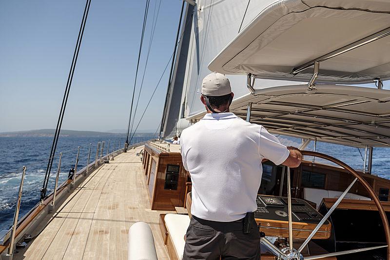 Aquarius sailing - helm and crew on deck