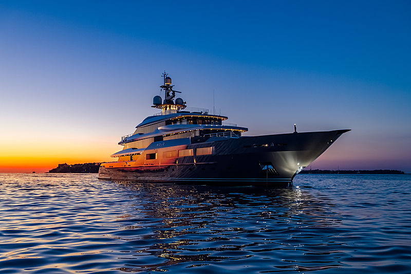 Solo yacht anchored at night
