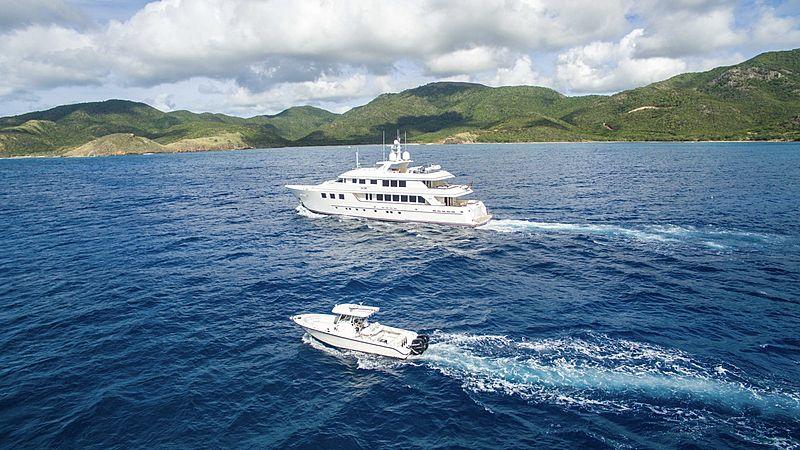 Mim yacht cruising with tender