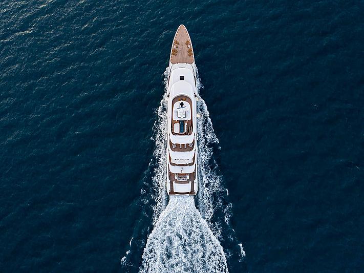 Dragon yacht cruising aerial